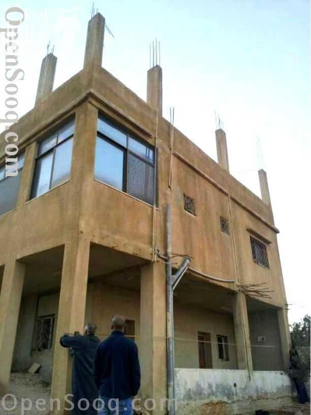 للبيع ارض بخليفة أ شارع عادي 100*100 بسعر 3250-  ارض مساحتها / 7.700 في...